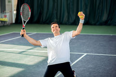 Happy male tennis player became a winner Royalty Free Stock Photos