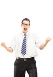 Happy male with tie gesturing happiness and looking at camera Royalty Free Stock Photo