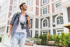 Happy male tourist enjoying city view Stock Photography