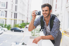 Happy male tourist photographing urban architecture Royalty Free Stock Image