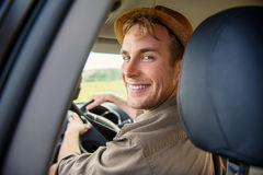 Happy male tourist traveling by transport Stock Image