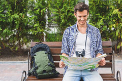 Happy male travelers making plan of journey Stock Photography