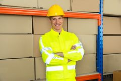 Happy Male Warehouse Worker With Arms Crossed Royalty Free Stock Images