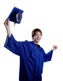 Happy malegraduate tossing hat. A happy young man in graduation gown tosses his cap in joy Royalty Free Stock Photos