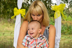 Happy Mama kisses Stock Images
