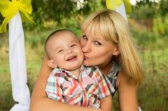 Happy Mama kisses Royalty Free Stock Photography