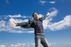 Happy man. On blue sky background Royalty Free Stock Images