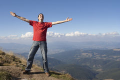 Happy man. Stands on the mountain Royalty Free Stock Photography