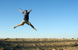 Happy man. A happy man jumping in the air stock photo