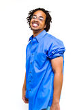 Happy Man. Good looking and smiling young man with a blue button up shirt poses against a bright white background Royalty Free Stock Photos