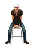Happy man. Laughing man on a white background sitting on a chair Stock Photography