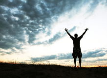 Happy man. Silhouette on sunset royalty free stock photography