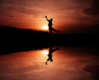 Happy man. Photo of a man celebrate his success at a mistic sunset Royalty Free Stock Photo