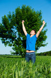 Happy man against tree and blue sky Stock Photos