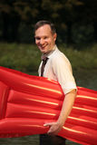 Happy man with air mattress Royalty Free Stock Photos