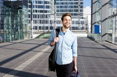 Happy man at airport leaving for vacation Stock Images