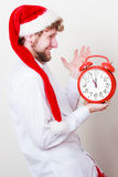 Happy man with alarm clock. Christmas time. Royalty Free Stock Images