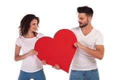 Happy Man And Woman Holding A Heart Royalty Free Stock Image