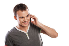 Happy man answering the phone isolated Stock Images