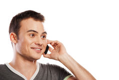 Happy man answering the phone isolated Royalty Free Stock Photo