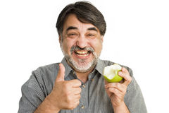 The happy  man apple Royalty Free Stock Photos