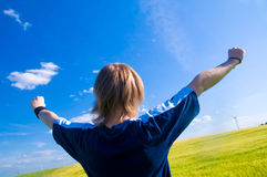 Happy man with arms up. On summer landscape Royalty Free Stock Image