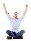 Happy man with arms up Stock Images
