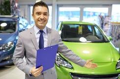 Happy man at auto show or car salon Stock Image
