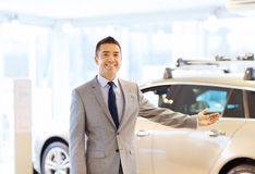 Happy man at auto show or car salon Stock Photography