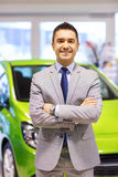 Happy man at auto show or car salon Royalty Free Stock Images