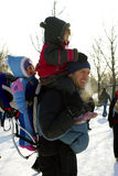 Bal-des-neiges. Festival montreal , jean drapeau parc. man with babies in winter clothing outdoors Stock Images