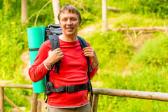 Happy man with a backpack hiking Royalty Free Stock Images