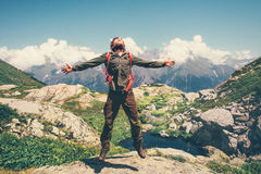 Happy Man with backpack jumping hands raised royalty free stock images