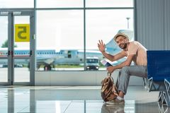 Man waving to someone in airport Stock Image