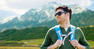 Happy man with backpack traveling in highlands Royalty Free Stock Photos