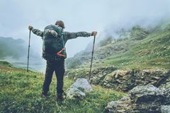 Happy Man backpacker hiking in foggy mountains Stock Image