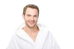 Happy man in bathrobe stock image