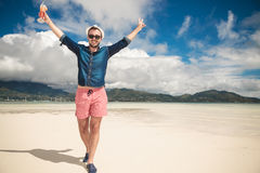 Happy man on the beach looking at the camera Royalty Free Stock Image