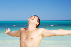 Happy man on the beach Royalty Free Stock Images