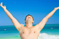 Happy man on the beach Royalty Free Stock Photography