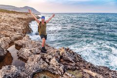 Happy man on the beach rock stock photos