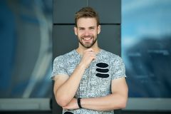 Happy man with beard on smiling face outdoor. Macho smile in grey tshirt. Casual in style. Happy and healthy. Sporty. Handsome guy. Confidence and charisma stock image