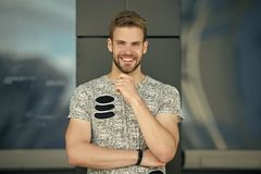 Happy man with beard on smiling face outdoor. Macho smile in grey tshirt. Casual in style. Happy and healthy. Sporty. Handsome guy. Confidence and charisma stock photography