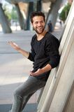 Happy man with beard smiling outdoors Royalty Free Stock Images