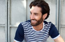Happy man with beard and striped shirt smiling Royalty Free Stock Photos
