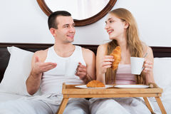 Happy man and beautiful girlfriend with tasty breakfast Royalty Free Stock Photography
