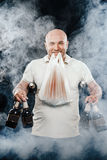 Happy man with a beer. Happy man with lots of beer on a black background stock image