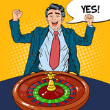 Happy Man Behind Roulette Table Celebrating Big Win. Casino Gambling. Pop Art. Vector retro illustration Royalty Free Stock Images