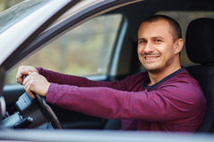 Happy man behind the wheel of a new car Stock Photography