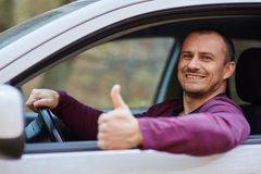 Happy man behind the wheel of a new car Royalty Free Stock Photo